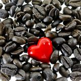 Coffee heart. Closeup Red heart on coffee beans on white background Royalty Free Stock Photo