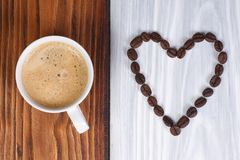 Coffee and heart from coffee beans Stock Photography