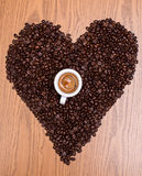 Coffee heart with espresso. Heart of coffee beans with espresso cup Stock Image