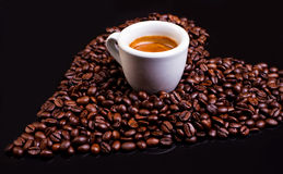 Coffee heart with espresso. Heart of coffee beans with espresso cup Royalty Free Stock Photo