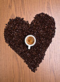 Coffee heart with espresso. Heart of coffee beans with espresso cup Royalty Free Stock Photography