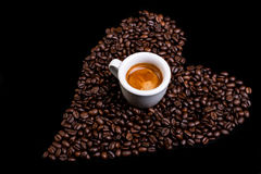 Coffee heart with espresso. Heart of coffee beans with espresso cup Stock Images