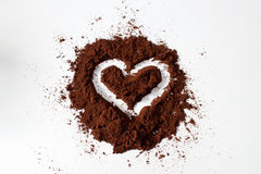 Coffee and heart. With ground coffee black heart on a white background Royalty Free Stock Photos