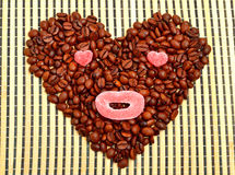 Coffee heart with jellies on bamboo mat Stock Image
