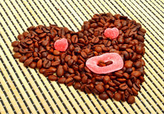 Coffee heart with jellies on bamboo mat Royalty Free Stock Photos
