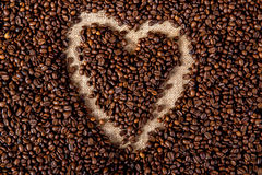 Coffee heart. Heart in a lot of coffee beans Royalty Free Stock Images