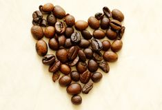 Coffee heart. Heart made of coffee beans on light background stock images
