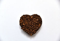 Coffee heart. Heart made of coffee beans on white background. Flat. Free space. Horizontal Royalty Free Stock Photography