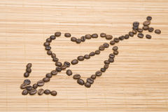 Coffee heart pierced by an arrow Stock Images