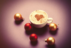 Coffee with heart shape and christmas bubbles Royalty Free Stock Image