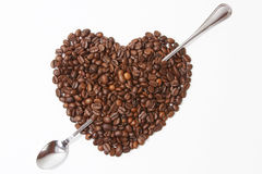 Coffee with heart shaped beans Stock Photography