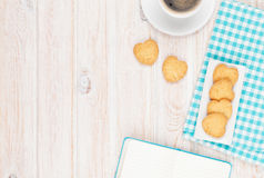 Coffee, heart shaped cookies and notepad Stock Photos