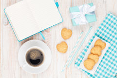 Coffee, heart shaped cookies and notepad Stock Image