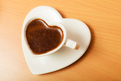 Coffee in heart shaped cup mug. Caffeine energy. Stock Image