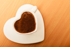 Coffee in heart shaped cup mug. Caffeine energy. Stock Images