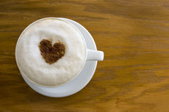 Coffee with heart on table Stock Photo