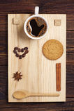 Coffee, hearts and oatmeal cookie Stock Photos