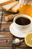 Coffee, honey and bread on table Stock Image