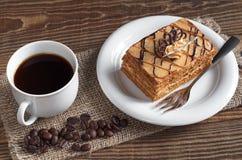Coffee and honey cake Stock Photos