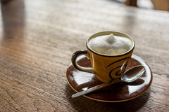 Coffee. Hot cappuchino coffee on wooden table royalty free stock photography