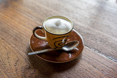 Coffee. Hot cappuchino coffee on wooden table royalty free stock photo