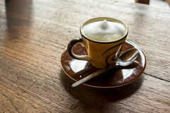 Coffee. Hot cappuchino coffee on wooden table royalty free stock images