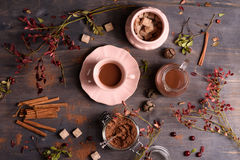 Coffee, hot chocolate or cocoa with cinnamon on rustic wooden background. Top view, copy space. Royalty Free Stock Photography