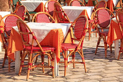 Coffee house. Red wicker chairs Royalty Free Stock Photography
