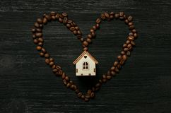 Coffee house and coffee beans heart shape. royalty free stock image