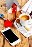 Coffee, House, Sketch and Phone on Wooden Table Royalty Free Stock Photos