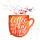 Coffee is a hug in a mug. Beautiful handwritten quote on a watercolor mug background Royalty Free Stock Photography