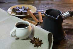 The coffee in the ibrik with cinnamon and chocolate. stock image