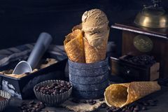 Coffee ice cream. In the cone royalty free stock photo