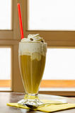 Coffee with ice cream and whipped cream. A scene in a cafe Stock Image