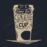 Coffee icon. Paper cup of coffee with lettering inside. Coffe cup on dark background Royalty Free Stock Photos