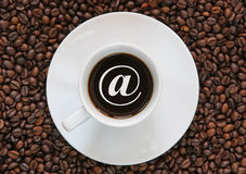 Coffee with an internet sign. Cup of coffee with an internet sign Stock Images