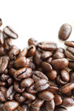 Coffee Invitation. Coffee beans on white background. Room for text at the top for your tag line. Let's meet for coffee Royalty Free Stock Images