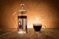 Coffee in jar with coffee cup Stock Images