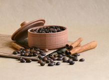 Coffee in the box and coffee beans on table royalty free stock photo