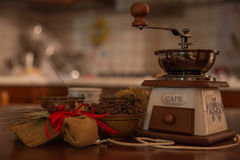 Coffee and jute. Coffee seeds in copper bowls with liquid coffee cup and coffee grinder near a composition jute Stock Photography