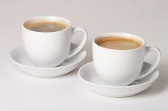 Coffee - Kaffee. Two Cups of coffee on white Background - zwei Tassen Kaffee vor weissem Hintergrund royalty free stock image