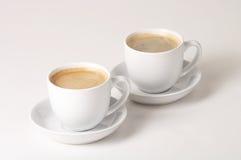 Coffee - Kaffee. Two Cups of coffee on white Background - zwei Tassen Kaffee vor weissem Hintergrund royalty free stock photos