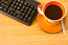 Coffee and keyboard. Business objects. keyboard and cup of coffee Stock Photo