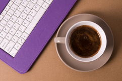 Coffee and keyboard Stock Images