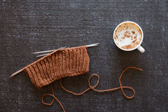Coffee and knitting on black background Royalty Free Stock Images