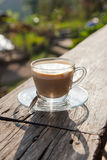 Coffee laid on wooden terrace Royalty Free Stock Image