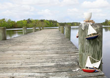 Coffee at the lake in the morning. White cup balancing on pier at water way stock image