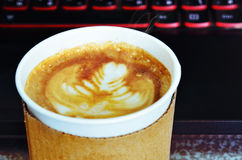 Coffee and a laptop Stock Image