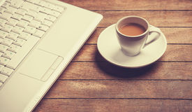 Coffee and laptop Stock Photography