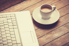 Coffee and laptop Stock Image